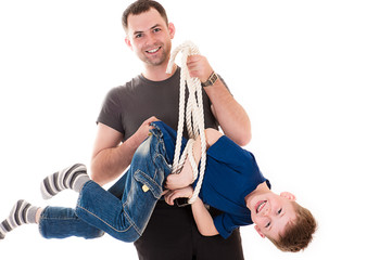 smiling father holding his son caught in the rope