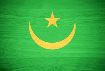 Mauritania flag on wood texture
