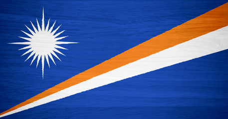 Marshall Islands flag on wood texture