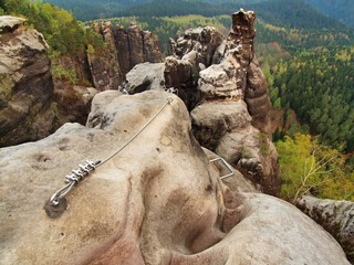 Easy via ferrata in rocks of Saxony Switzerland. Iron rope.