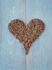 Organic cacao nibs shaped in heart symbol
