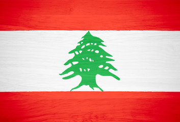 Lebanon flag on wood texture