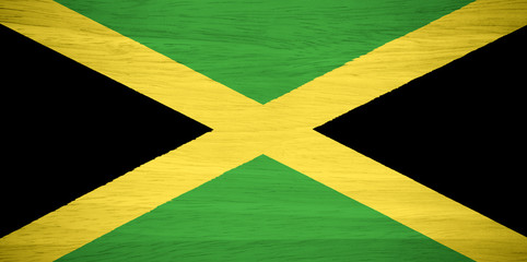 Jamaica flag on wood texture