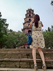 Woman Tourist taking photos at Thien Mu Pagoda, Hue, Vietnam