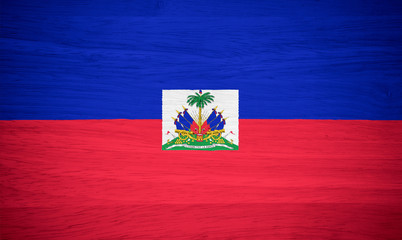 Haiti flag on wood texture
