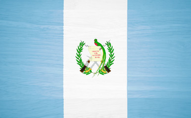 Guatemala flag on wood texture