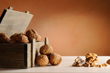 group of walnuts on a table with trunk wooden container