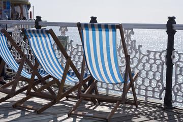 Empty deck chairs on Brighton pier