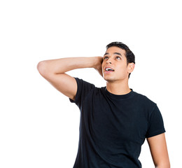 Man looking up, having headache from loud noise