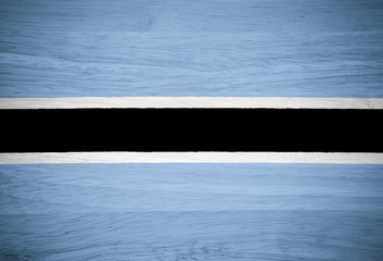 Botswana flag on wood texture