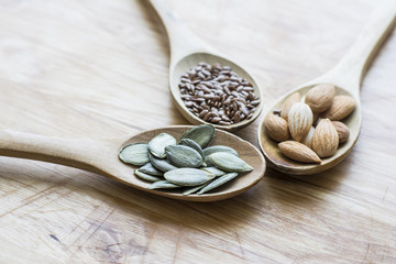 Healthy seeds in wooden spoons