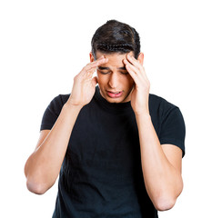 Young man having headache, stressed, tired, fatigued