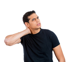 Young overworked man, student  having neck pain