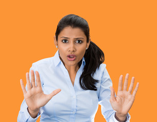 stop! Offended woman asking to stay away, orange background