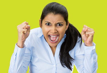Portrait upset pissed off woman, screaming, green background