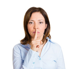 Silence please, shut up quiet. Woman with finger on lips gesture
