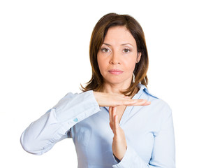 Serious middle aged woman giving time out gesture