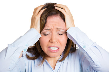 Stressed, overwhelmed woman having bad headache