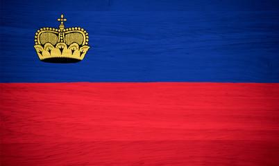Liechtenstein flag on wood texture