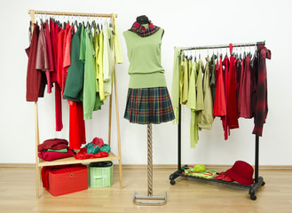 Dressing closet with complementary colors red and green clothes.
