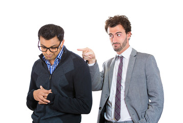 Young sad employee fired by angry boss isolated on white
