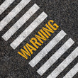 Warning concept : paint on asphalt road