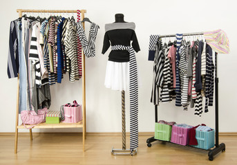 Dressing closet with striped clothes on hangers and mannequin