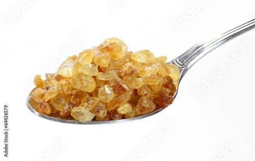 Cane sugar on spoon