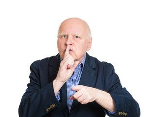 Shush. Portrait senior man gesturing keep quiet, finger on lips