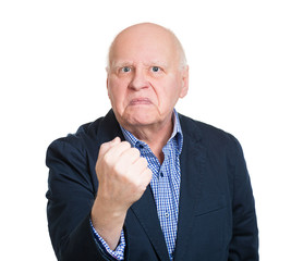 Portrait angry old man giving fist for you, white background