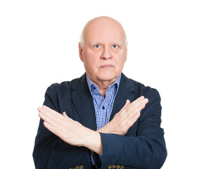Senior man giving do not enter hand gesture, white background