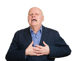 Senior man having chest pain, isolated white background
