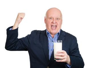 energetic old man holding glass of milk looks healthy and happy