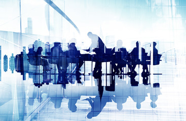 Business People's Silhouettes in a Meeting