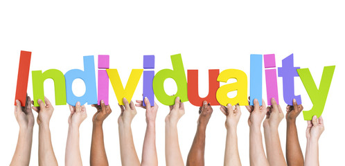 Multiethnic Group of Hands Holding Word Individuality