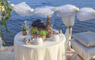 Table setting on the sea shore.