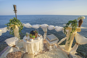 Table set for an event party or wedding on the sea.