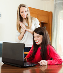 Two young women  with laptop