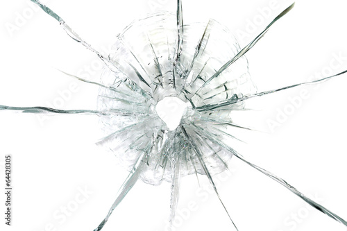 large bullet hole in glass abstract background - 64428305