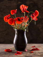 Bunch of poppies in vase