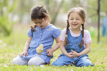 Two little girls with chickens
