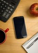 Overhead of smartphone with calculator