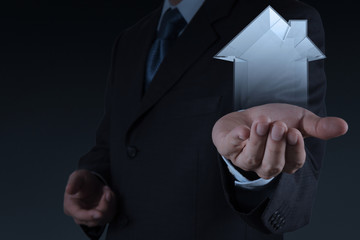 businessman hand holding 3d house as insurance concept