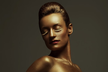 Creative make-up concept. Sleeping golden beauty