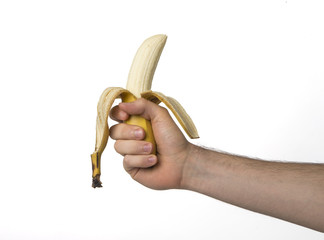 Hand holding a banana on white background, contoured