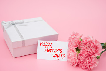 card of happy mother's day  and present box and pink carnations
