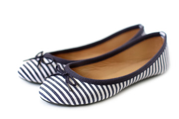 Women's striped shoes on white background