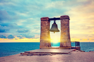 Ancient bell at sunset. In ancient city Chersonesos, Sevastopol,