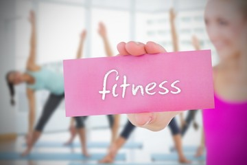 Fit blonde holding card saying fitness