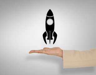 Composite image of female hand presenting rocket